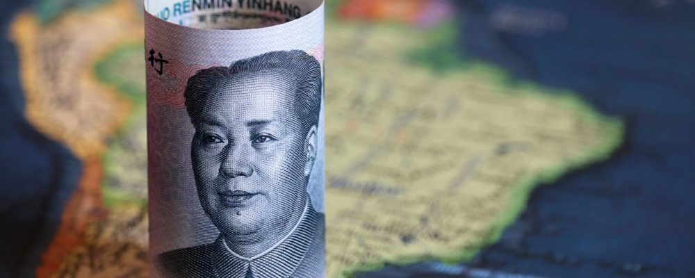 Chinese yuan on the map of South America. Trading between China and Latin American countries, economy and investment